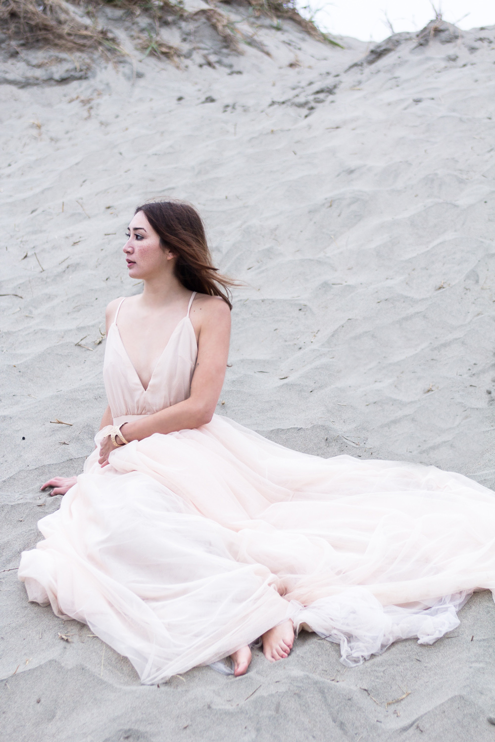 Against the Tide Alyssa Nicole Blush Tulle Gown at Ocean Beach